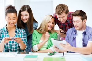 education, technology and internet - students looking at smartphones and tablet pc
